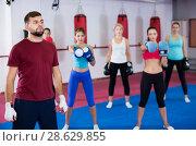 Купить «women are boxing and doing kick with coach», фото № 28629855, снято 8 октября 2017 г. (c) Яков Филимонов / Фотобанк Лори