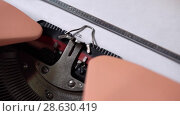 Купить «Typing on retro typewriter», видеоролик № 28630419, снято 23 июня 2018 г. (c) Andriy Bezuglov / Фотобанк Лори