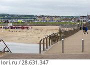 Купить «General view at Portrush beach and houses in the distance», фото № 28631347, снято 1 июля 2017 г. (c) Ольга Марк / Фотобанк Лори
