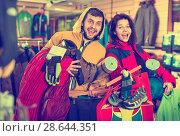 Купить «Young couple demonstrating tourist equipment», фото № 28644351, снято 8 марта 2017 г. (c) Яков Филимонов / Фотобанк Лори