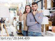 Купить «Happy couple in furnishings store», фото № 28644499, снято 9 ноября 2017 г. (c) Яков Филимонов / Фотобанк Лори