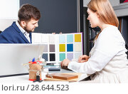 Купить «Competent seller in showroom helping young female client to choose furniture materials for her apartment», фото № 28644523, снято 9 апреля 2018 г. (c) Яков Филимонов / Фотобанк Лори
