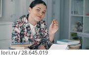 Купить «Woman with a pencil prepare for exam», видеоролик № 28645019, снято 28 марта 2018 г. (c) Илья Шаматура / Фотобанк Лори