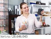 Купить «Woman choosing bottle for liquid soap for home in supermarket», фото № 28646043, снято 2 мая 2018 г. (c) Яков Филимонов / Фотобанк Лори