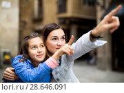 Купить «Mother and daughter pointing at sight during», фото № 28646091, снято 18 июля 2018 г. (c) Яков Филимонов / Фотобанк Лори