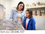 Купить «Mother and daughter regarding classical bas-reliefs», фото № 28646107, снято 18 июля 2018 г. (c) Яков Филимонов / Фотобанк Лори