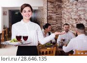 Купить «Smiling woman waiter carrying order for visitors», фото № 28646135, снято 17 января 2017 г. (c) Яков Филимонов / Фотобанк Лори