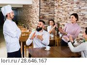 Happy chef listens to praise of the food. Стоковое фото, фотограф Яков Филимонов / Фотобанк Лори