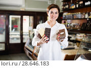 Woman choosing chocolate bar. Стоковое фото, фотограф Яков Филимонов / Фотобанк Лори