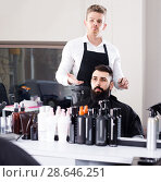 Купить «client feeling discontent about his new haircut at hair salon», фото № 28646251, снято 27 января 2017 г. (c) Яков Филимонов / Фотобанк Лори