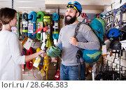 Купить «Smiling climbers examining alpinism equipment items», фото № 28646383, снято 24 февраля 2017 г. (c) Яков Филимонов / Фотобанк Лори
