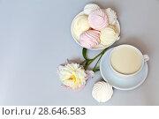 Купить «Still life with zefirs and a mug of oat milk (Ne-moloko) on a light background. Traditional Russian sweetness», фото № 28646583, снято 27 июня 2018 г. (c) Виктория Катьянова / Фотобанк Лори