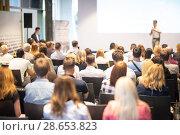 Купить «Business speaker giving a talk at business conference event.», фото № 28653823, снято 15 июня 2018 г. (c) Matej Kastelic / Фотобанк Лори