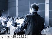 Купить «Public speaker giving talk at Business Event.», фото № 28653831, снято 3 июля 2014 г. (c) Matej Kastelic / Фотобанк Лори