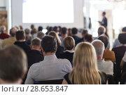 Купить «Business speaker giving a talk at business conference event.», фото № 28653847, снято 16 июля 2018 г. (c) Matej Kastelic / Фотобанк Лори