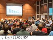 Купить «Business speaker giving a talk at business conference event.», фото № 28653851, снято 16 июля 2018 г. (c) Matej Kastelic / Фотобанк Лори