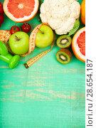 Купить «Food for diet and dumbbells», фото № 28654187, снято 14 апреля 2018 г. (c) Елена Блохина / Фотобанк Лори