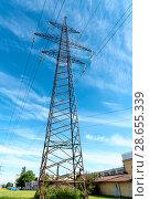 Купить «Опора линии электропередач», эксклюзивное фото № 28655339, снято 27 июня 2018 г. (c) Александр Щепин / Фотобанк Лори