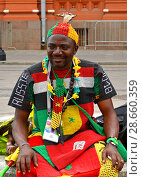 2018 FIFA World Cup. Fan from Cameroon (Central Africa) in center of Moscow. Редакционное фото, фотограф Валерия Попова / Фотобанк Лори