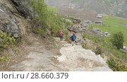 Купить «Couple walking along the stairs on the trek around Manaslu, village Prok, Nepal», видеоролик № 28660379, снято 17 июня 2018 г. (c) Dzmitry Astapkovich / Фотобанк Лори