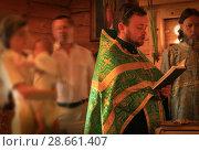 Купить «Священник читает требник во время крещения на Троицу», эксклюзивное фото № 28661407, снято 23 мая 2010 г. (c) Олеся Сарычева / Фотобанк Лори