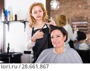 Купить «Haircut master is doing hairstyle and cut by means of scissors», фото № 28661867, снято 7 марта 2017 г. (c) Яков Филимонов / Фотобанк Лори
