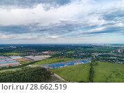 Купить «Aerial view of wheat fields, meadow, forest and village in rural Russia.», фото № 28662519, снято 11 июня 2018 г. (c) Андрей Радченко / Фотобанк Лори