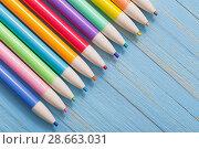 Купить «pencils on blue wooden background», фото № 28663031, снято 26 июня 2018 г. (c) Майя Крученкова / Фотобанк Лори