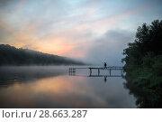 Купить «Летний пейзаж с рассветом над рекой и рыбаком на мостке», эксклюзивное фото № 28663287, снято 24 мая 2018 г. (c) Игорь Низов / Фотобанк Лори