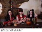 Купить «Три цыганки гадают на картах», фото № 28663307, снято 13 мая 2018 г. (c) Марина Володько / Фотобанк Лори