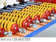 Купить «A row of shock absorbers for car», фото № 28663555, снято 30 июня 2018 г. (c) Ирина Аринина / Фотобанк Лори
