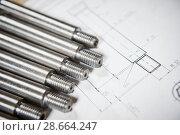 Купить «Engineering and metalworking industry. Metal details on print drawing», фото № 28664247, снято 1 марта 2016 г. (c) Дмитрий Калиновский / Фотобанк Лори