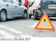 Accident or crash with two automobile. Road warning triangle sign in focus. Стоковое фото, фотограф Дмитрий Калиновский / Фотобанк Лори