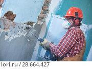 Купить «worker with demolition hammer breaking interior wall», фото № 28664427, снято 8 декабря 2017 г. (c) Дмитрий Калиновский / Фотобанк Лори