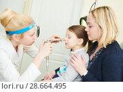 Купить «female doctor of ENT ear nose throat at work examining girl nose», фото № 28664495, снято 27 февраля 2018 г. (c) Дмитрий Калиновский / Фотобанк Лори