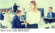 Portrait of unhappy girl in modern open plan office on background with coworkers. Стоковое фото, фотограф Яков Филимонов / Фотобанк Лори
