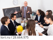 Купить «Team of adult engineers discussing new project», фото № 28664975, снято 7 декабря 2019 г. (c) Яков Филимонов / Фотобанк Лори