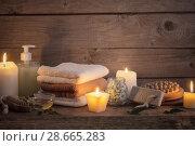 Купить «Beautiful composition of spa treatment on dark wooden background», фото № 28665283, снято 14 ноября 2017 г. (c) Майя Крученкова / Фотобанк Лори