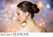 Купить «close up of beautiful woman face with earring», фото № 28674335, снято 9 апреля 2016 г. (c) Syda Productions / Фотобанк Лори