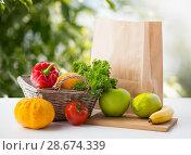 Купить «basket of fresh vegetables and fruits on table», фото № 28674339, снято 3 июня 2016 г. (c) Syda Productions / Фотобанк Лори