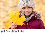 Купить «happy girl with fallen maple leaf at autumn park», фото № 28674367, снято 19 октября 2017 г. (c) Syda Productions / Фотобанк Лори