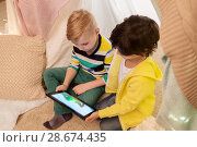 Купить «little boys with tablet pc in kids tent at home», фото № 28674435, снято 18 февраля 2018 г. (c) Syda Productions / Фотобанк Лори