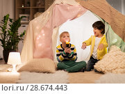 Купить «happy boys with torch light in kids tent at home», фото № 28674443, снято 18 февраля 2018 г. (c) Syda Productions / Фотобанк Лори