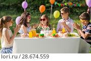 Купить «happy kids with cake on birthday party at summer», фото № 28674559, снято 27 мая 2018 г. (c) Syda Productions / Фотобанк Лори
