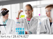 Купить «kids with test tubes studying chemistry at school», фото № 28674827, снято 19 мая 2018 г. (c) Syda Productions / Фотобанк Лори