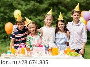 Купить «happy kids on birthday party at summer garden», фото № 28674835, снято 27 мая 2018 г. (c) Syda Productions / Фотобанк Лори