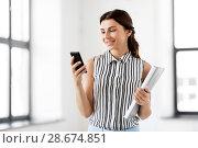 Купить «businesswoman with smartphone and folder at office», фото № 28674851, снято 8 июня 2018 г. (c) Syda Productions / Фотобанк Лори