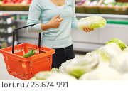 Купить «woman with basket and chinese cabbage at grocery», фото № 28674991, снято 2 ноября 2016 г. (c) Syda Productions / Фотобанк Лори