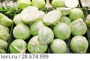 Купить «close up of cabbage at grocery store or market», фото № 28674999, снято 2 ноября 2016 г. (c) Syda Productions / Фотобанк Лори