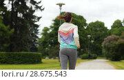 Купить «smiling woman running along park», видеоролик № 28675543, снято 25 июня 2018 г. (c) Syda Productions / Фотобанк Лори